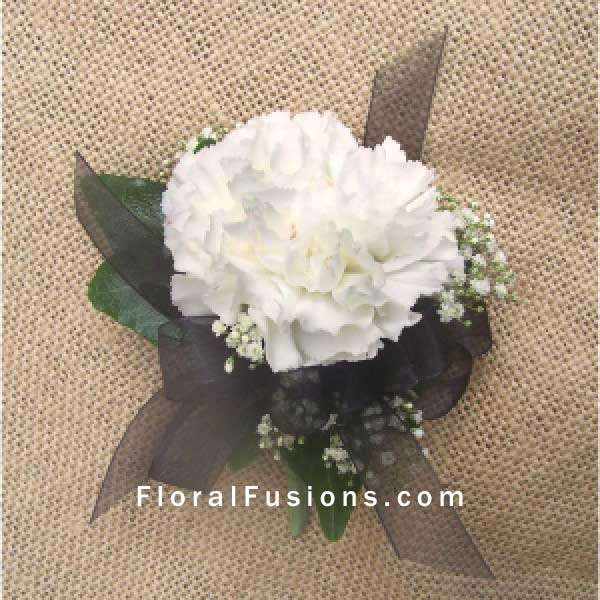 white carnation pin on corsage floral fusions leicester based
